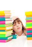 worry  schoolgirl with books