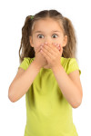 Little Girl Covering Her Mouth